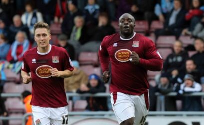 Adebayo Akinfenwa celebrates the first of his two goals against Wycombe on Saturday (Picture: Sharon Lucey)